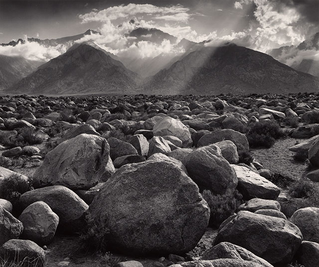 Ansel Adams made everything from the foreground rocks to the mountains appear in focus.